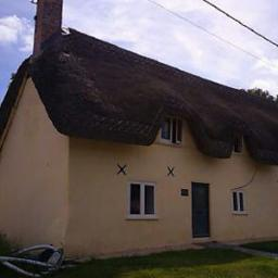 House painted with pure white limewash and a raw sienna pigment.