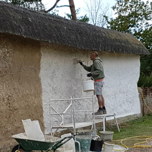 Limewash in use on a cob wall.